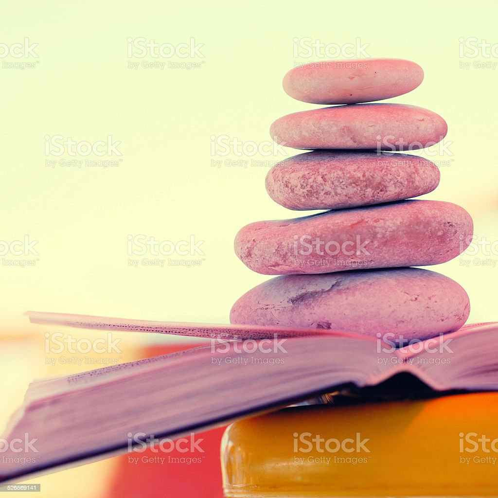 Pebbles stack on the book. stock photo