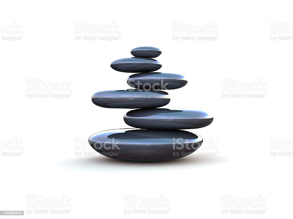 Pebbles stacked on each other on a white background stock photo
