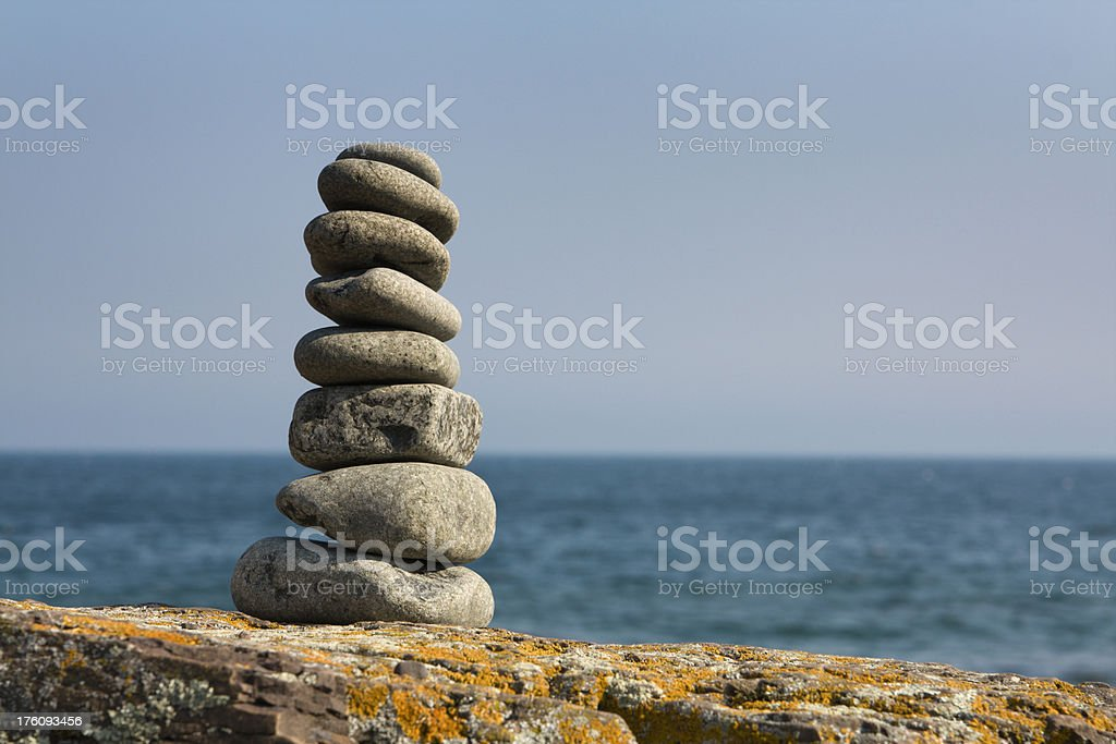 Pebbles Stacking on the Shore Hz royalty-free stock photo
