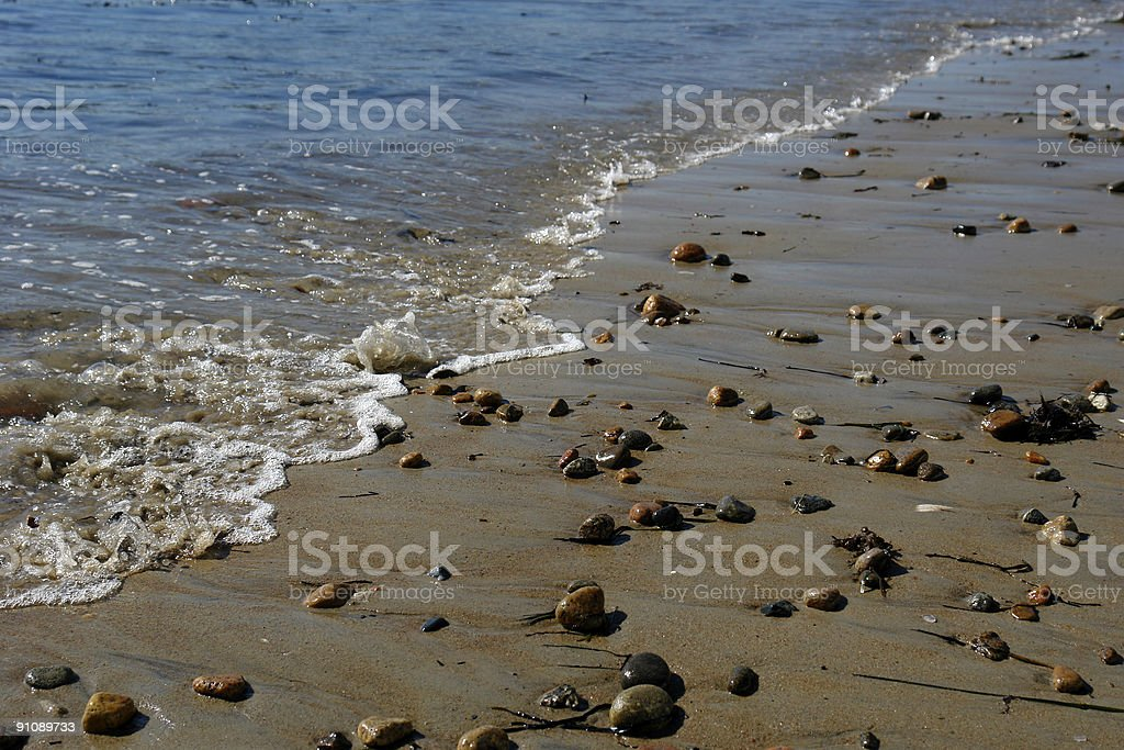 Pebbles waiting at the shore stock photo