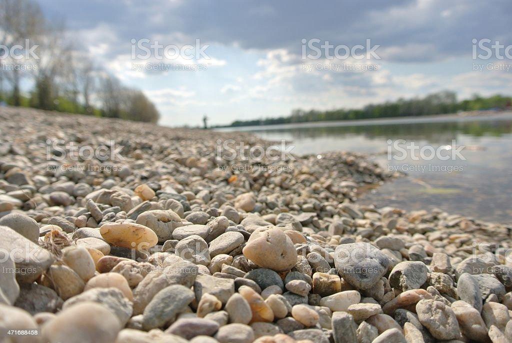 Pebbly lake shore in summer stock photo