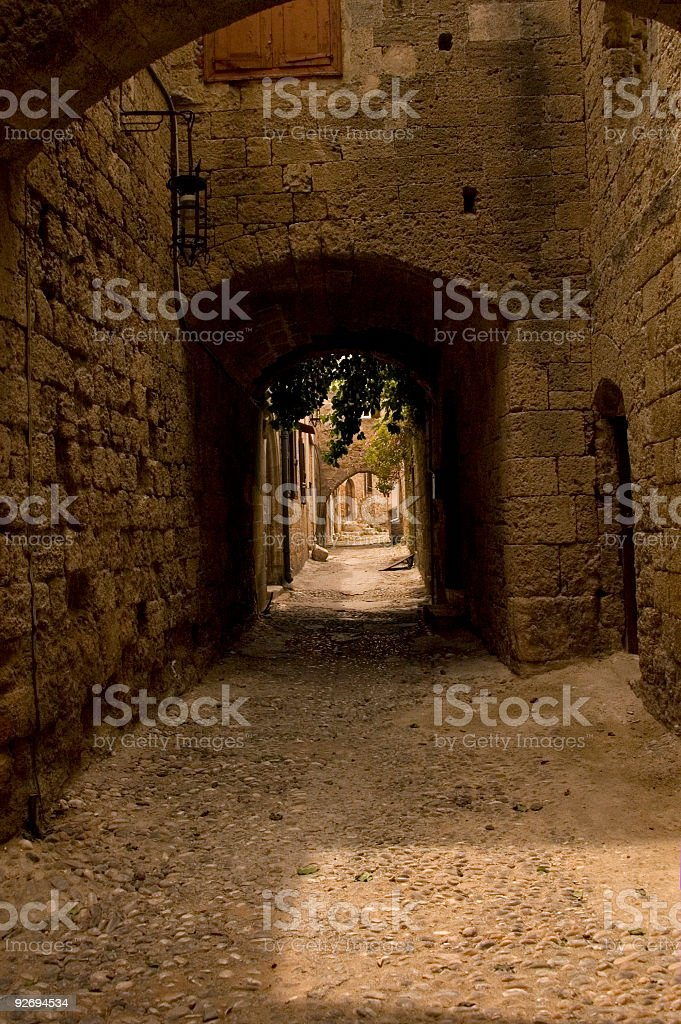 pebbly street of a medieval city stock photo