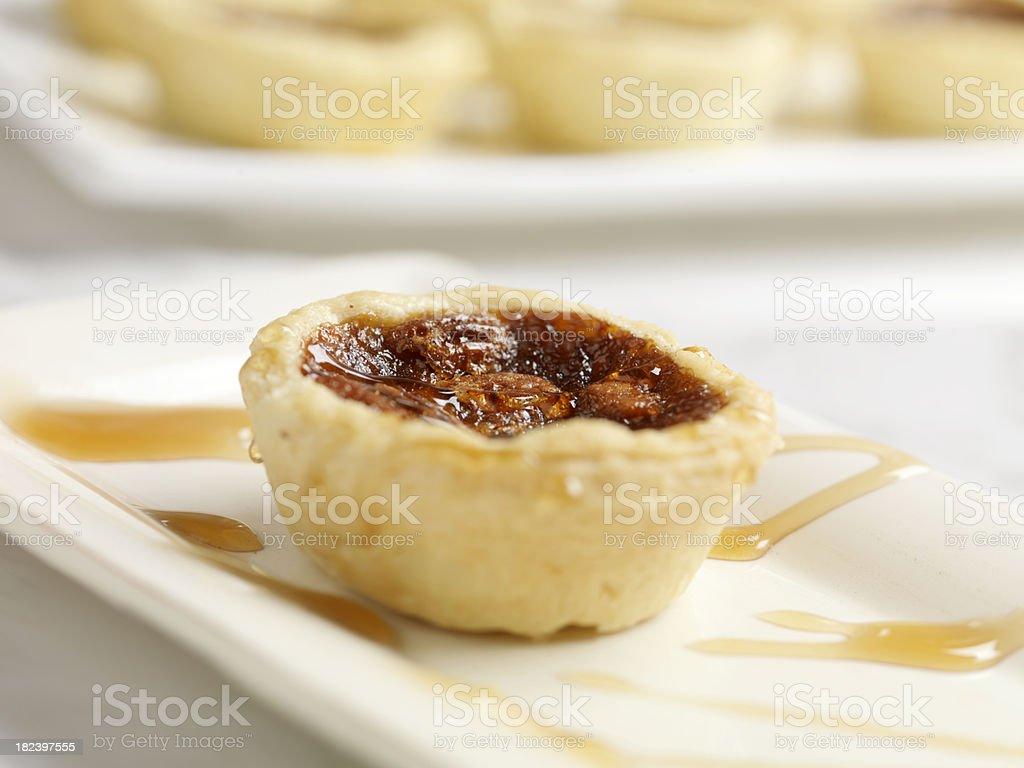 Pecan Butter Tart with Caramel Sauce royalty-free stock photo