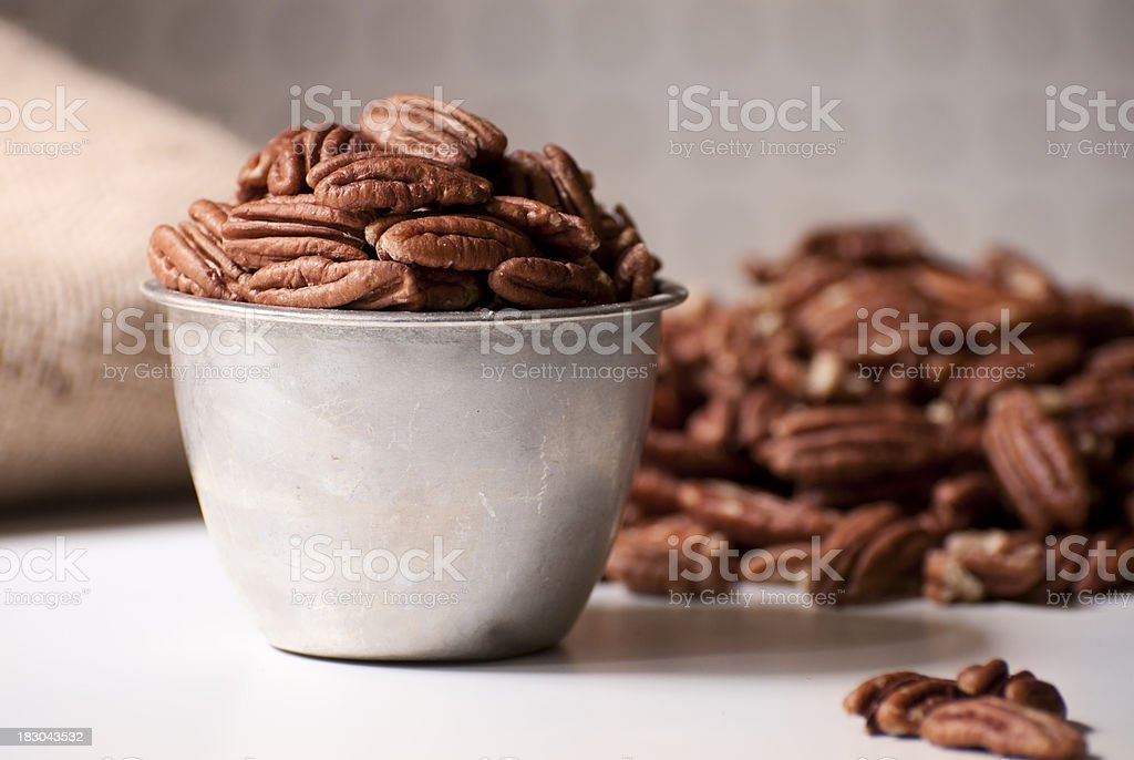 Pecan Halves Filling a Measuring Cup royalty-free stock photo