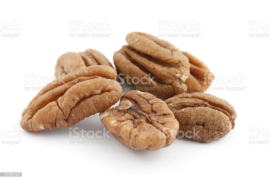 Pecan Halves on a White Background stock photo