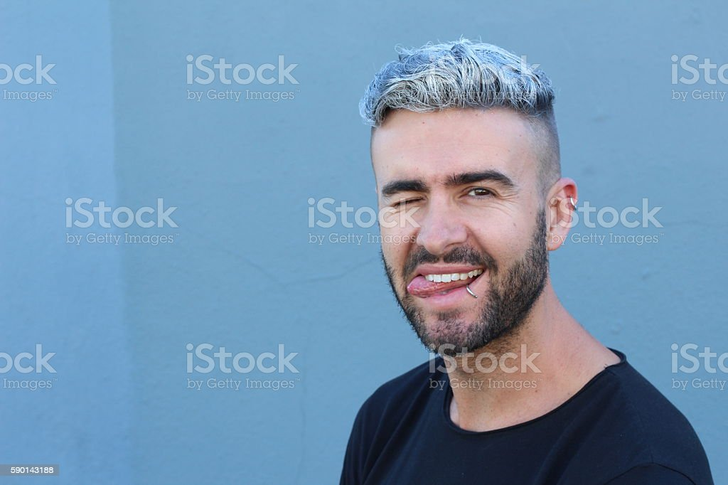 Peculiar guy making a funny face stock photo