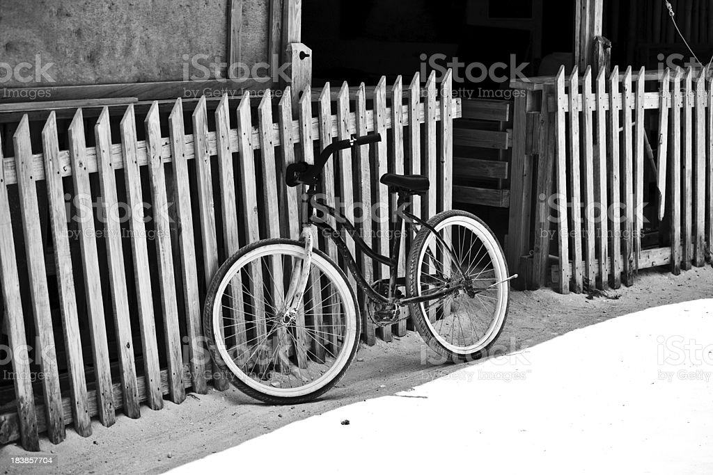 Pedal bike and picket fence royalty-free stock photo