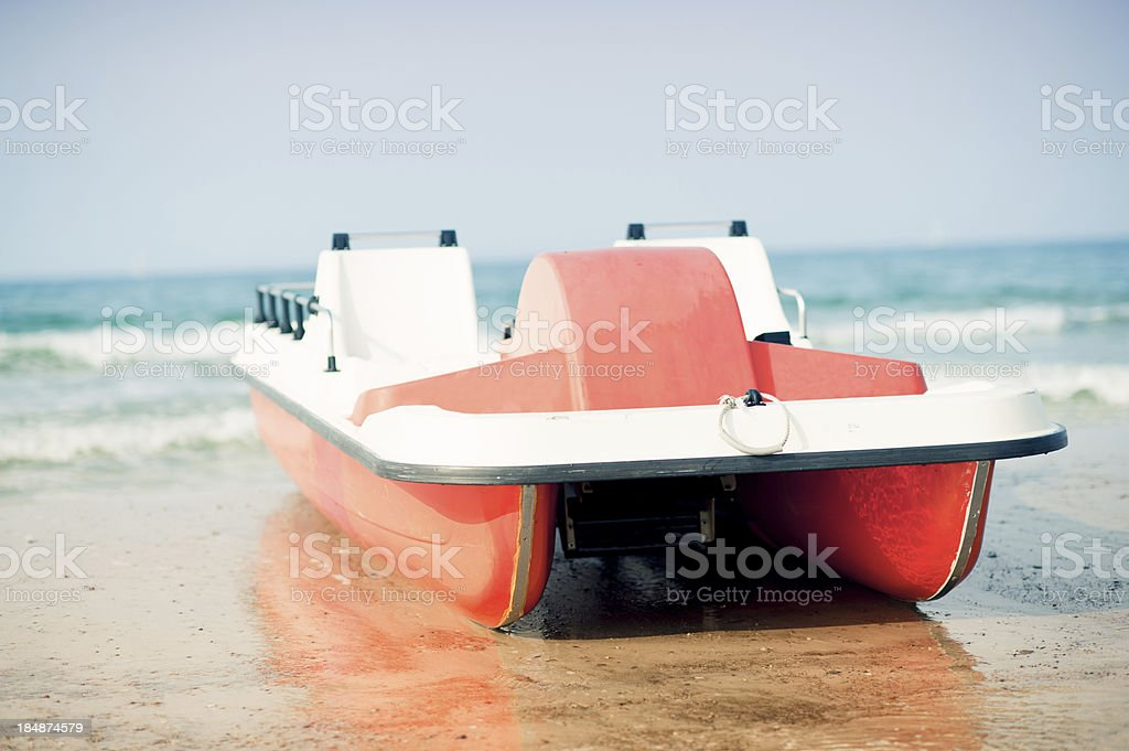 pedal boat on beach stock photo