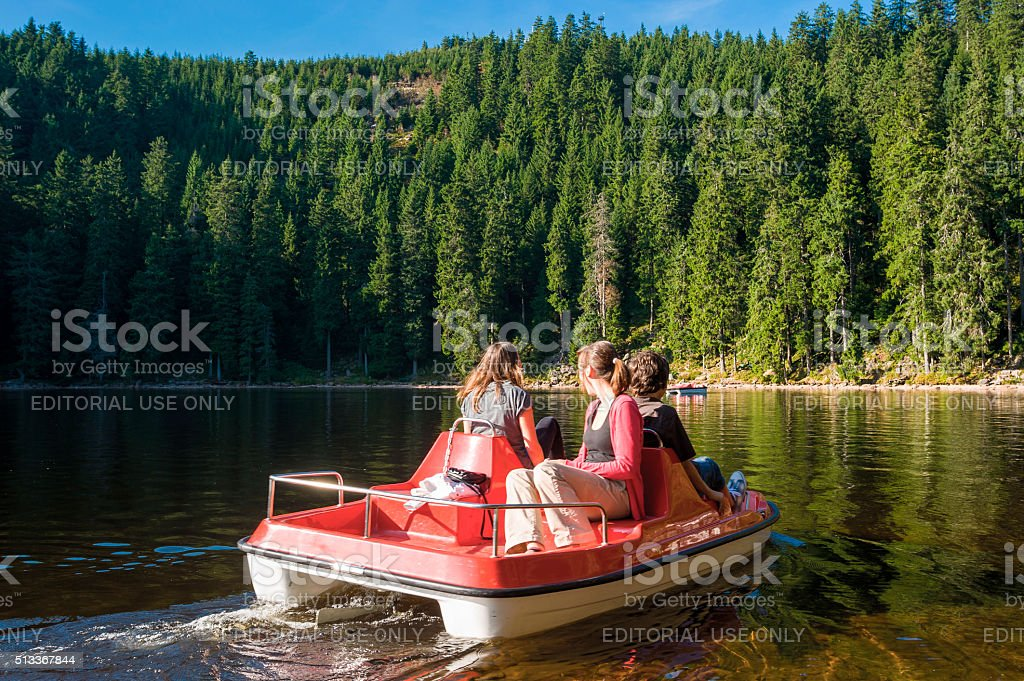 Pedal boat on the Mummelsee stock photo