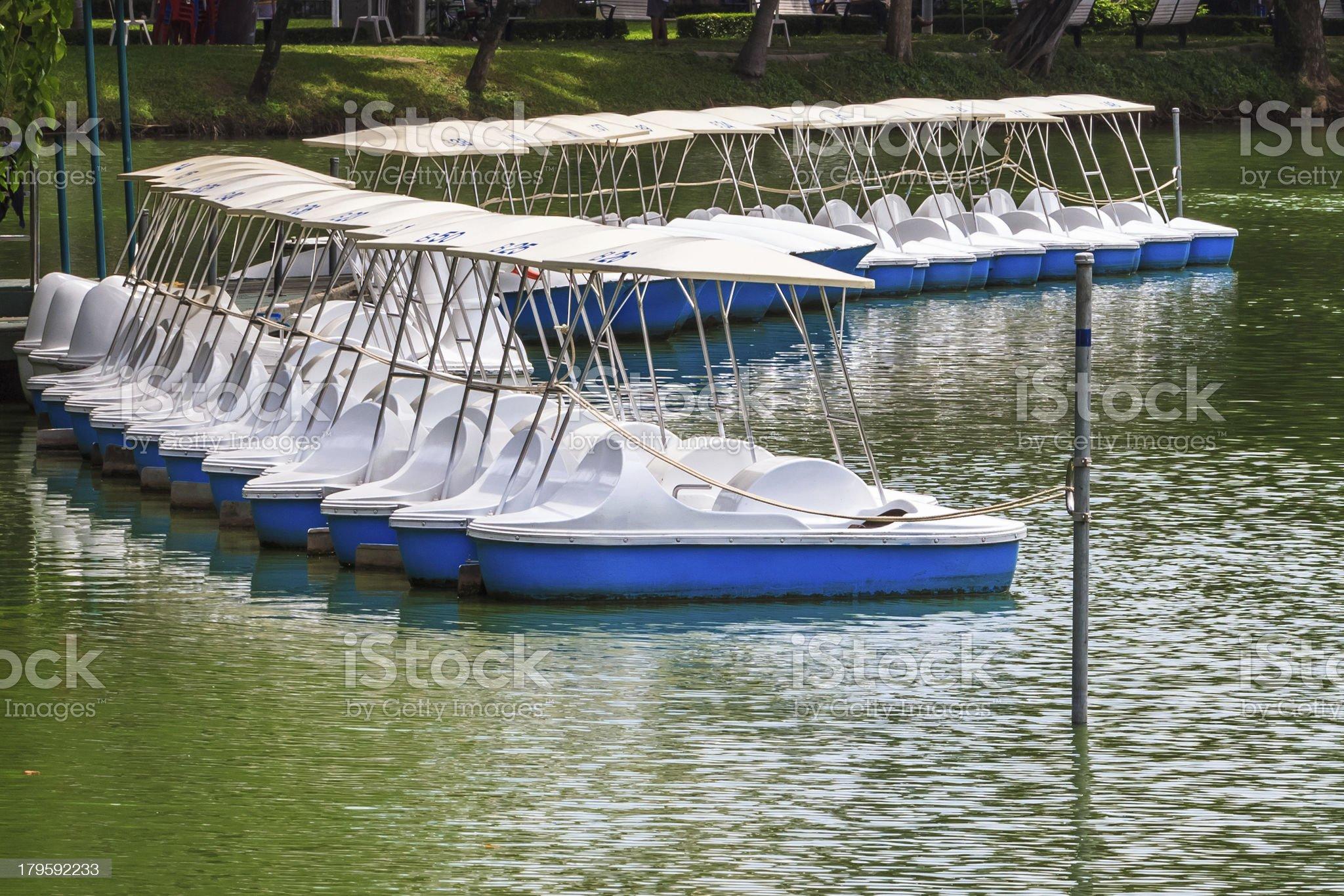 Pedal Boats locked at Peaceful Lake Marina, Recreation Equipment royalty-free stock photo