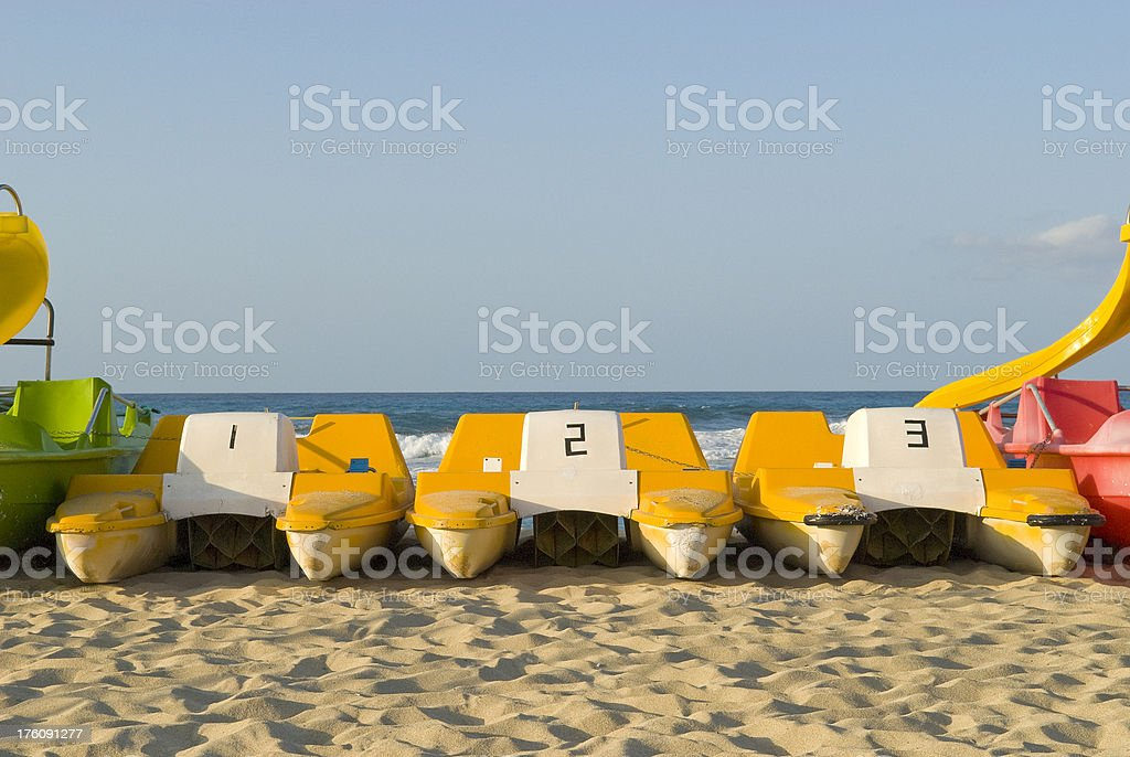 Pedalo boats on the beach numbered 1 2 3 royalty-free stock photo