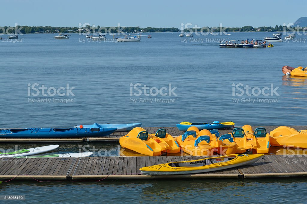 Pedalo or paddle boat is a small human-powered watercraft stock photo