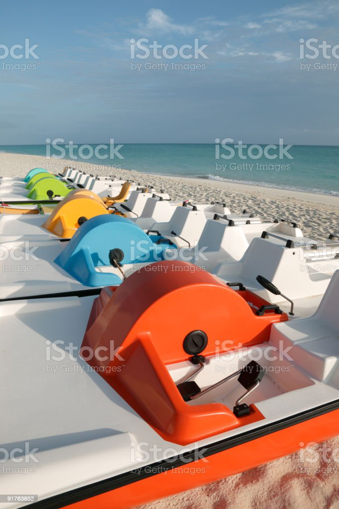 pedalos on the beach royalty-free stock photo
