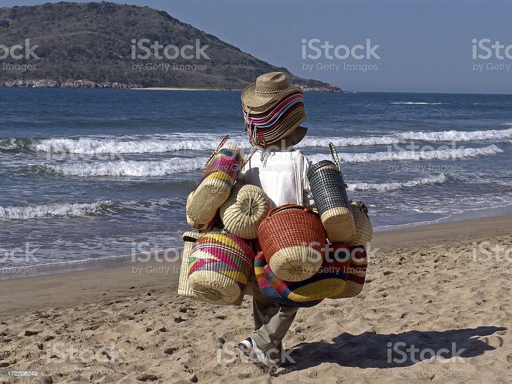 Peddler on Beach stock photo