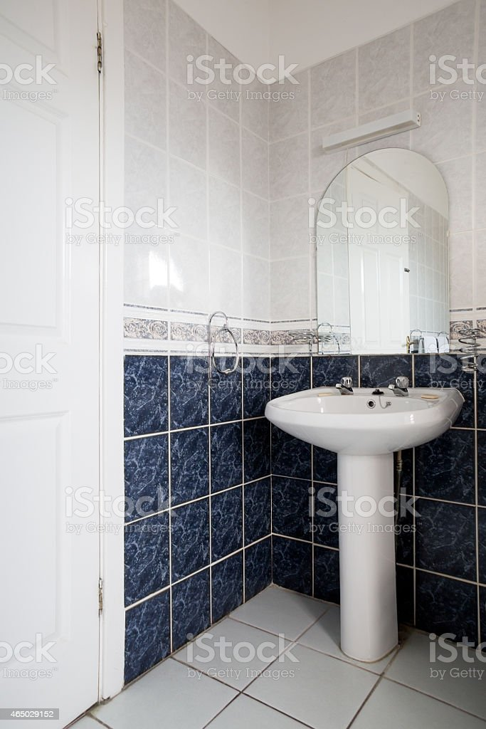 Pedestal sink in lovely bathroom stock photo