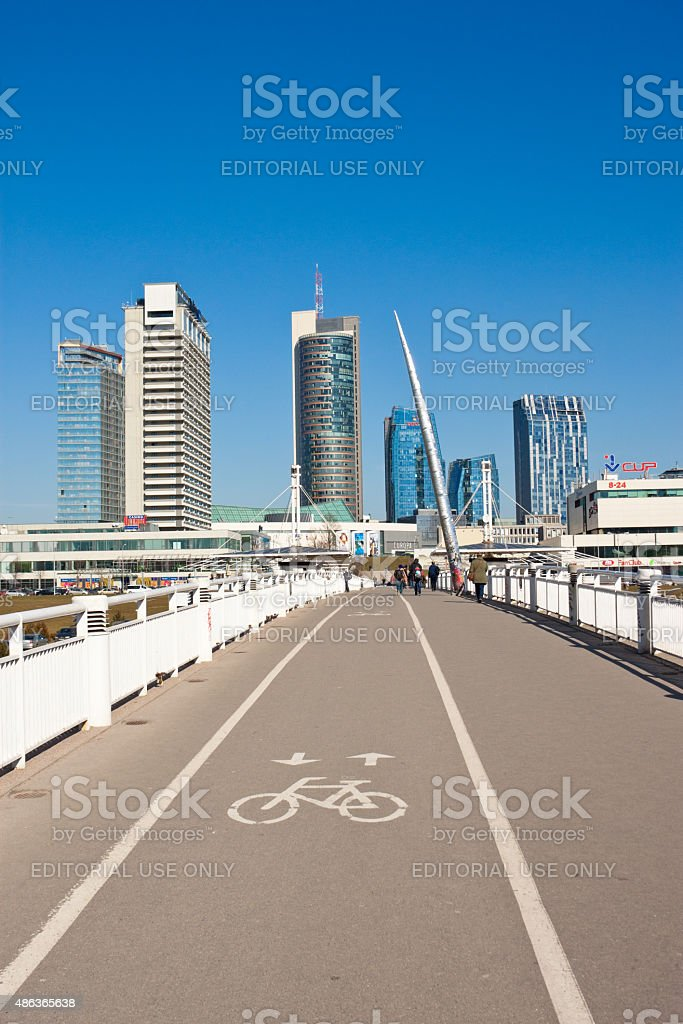 Pedestrian and bicycle bridge leading to modern buildings stock photo