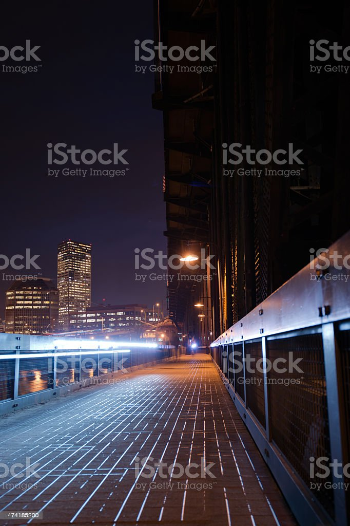 Pedestrian bicycle path with lanternson big old bridge Willamette river stock photo