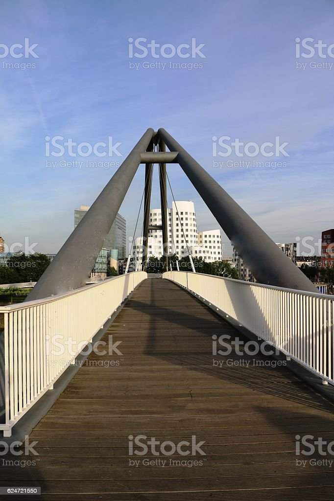 Pedestrian bridge across River Rhine to Medienhafen in Düsseldorf, Germany stock photo