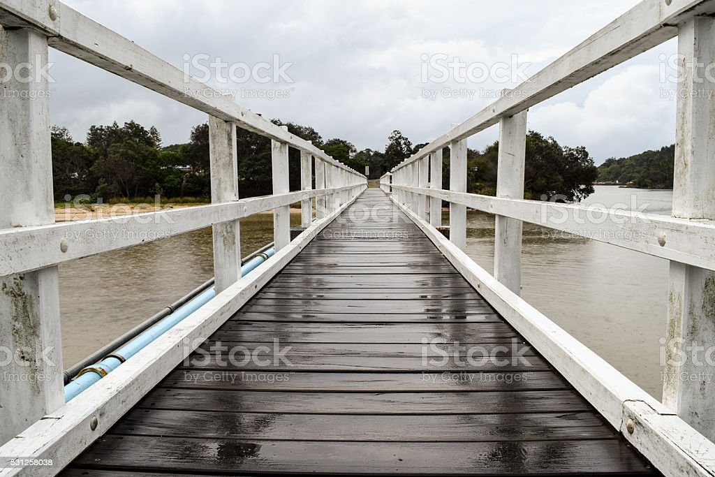 Pedestrian bridge crossing on an overcast and drizzly day stock photo