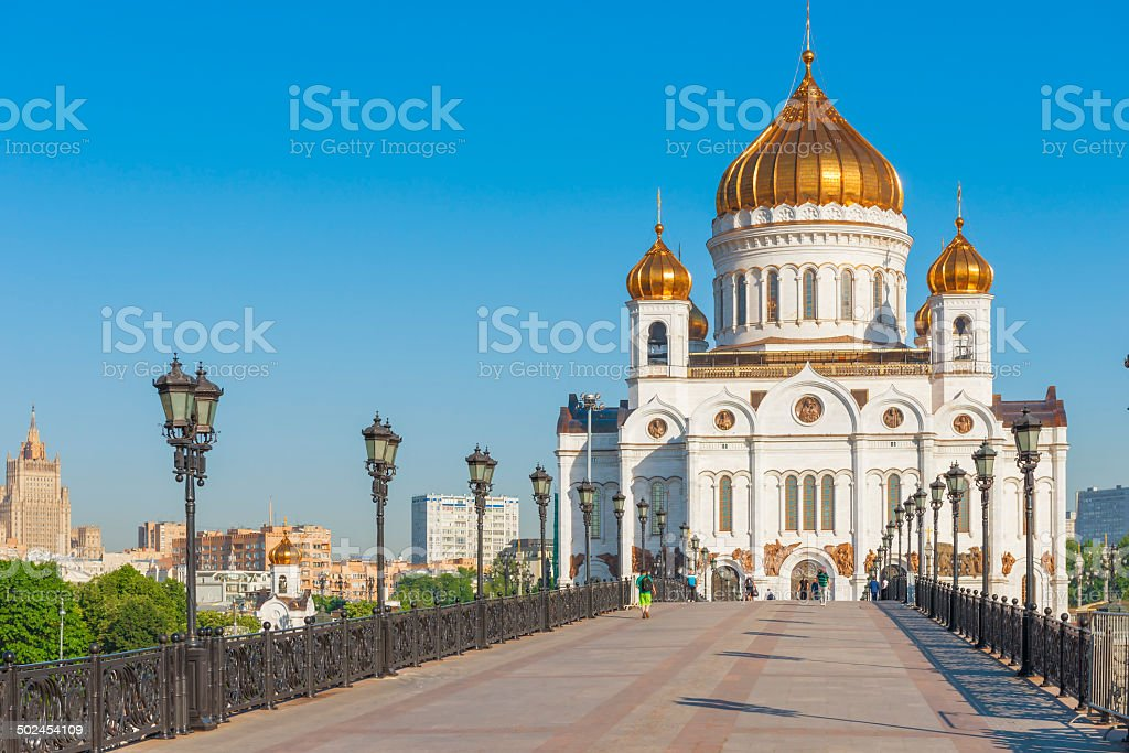 pedestrian bridge leading to the Christ the Savior Cathedral in stock photo