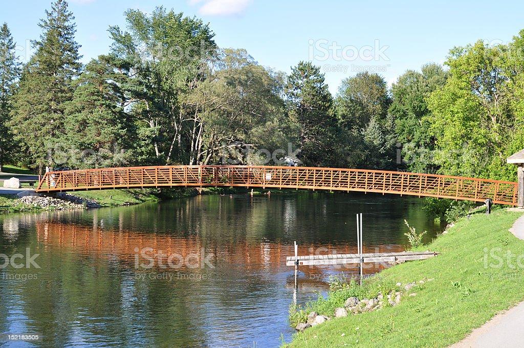 Pedestrian bridge over river stock photo