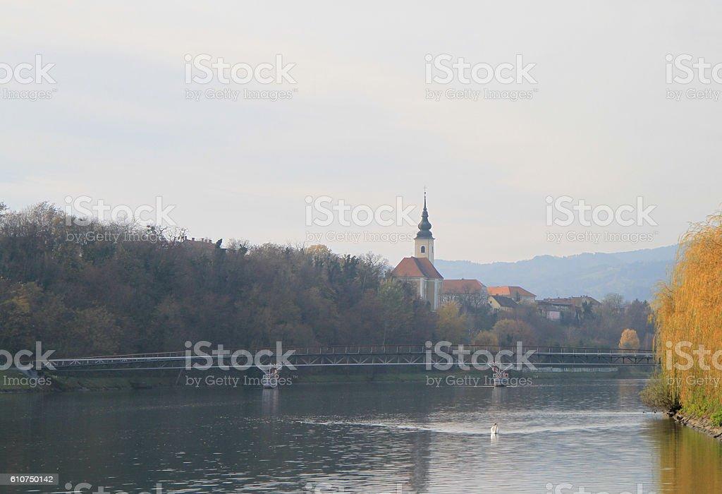 pedestrian bridge over the Drava river in Maribor stock photo