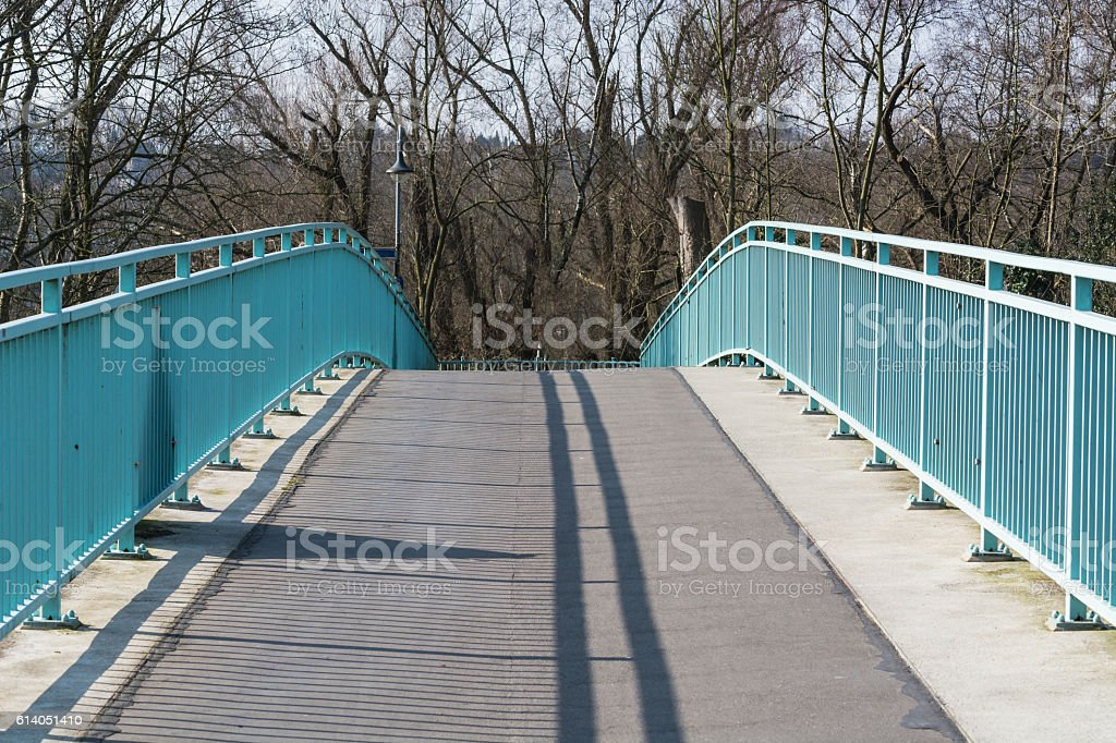 Pedestrian bridge steel arch structure over the river stock photo