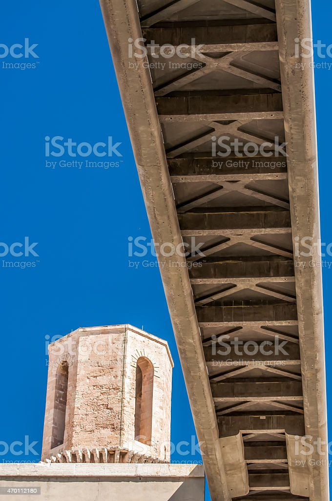 Pedestrian bridge viewed from below against blue sky stock photo