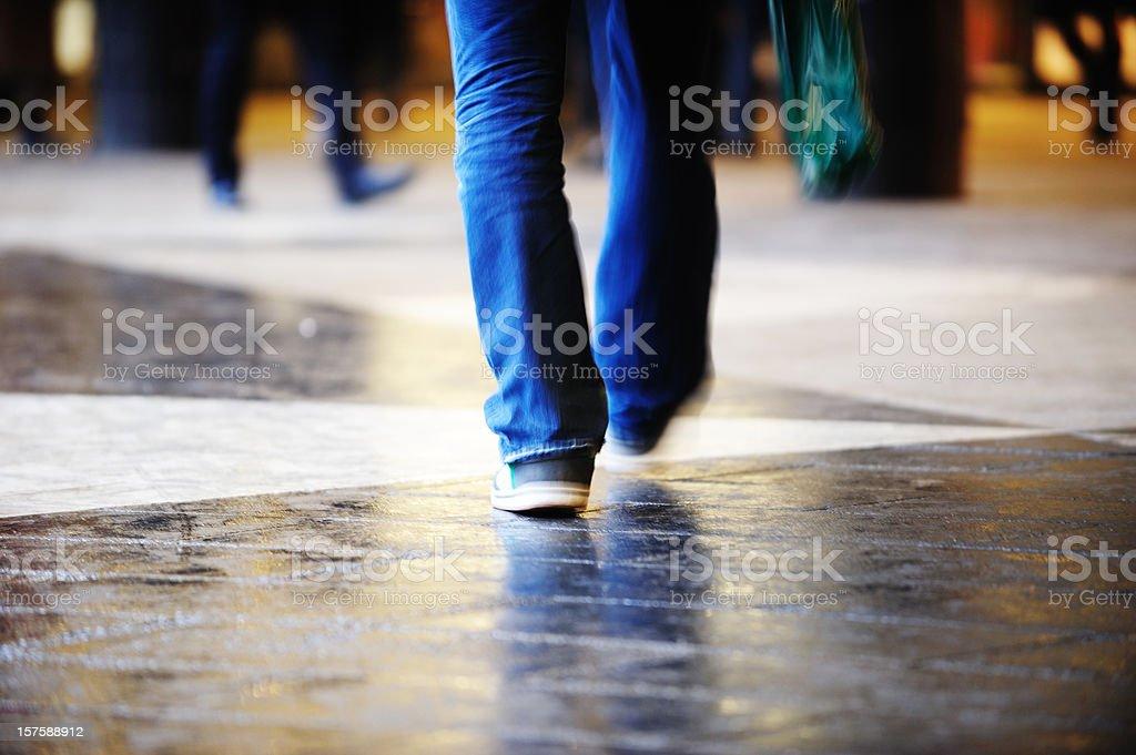 Pedestrian crossing rain wet square stock photo