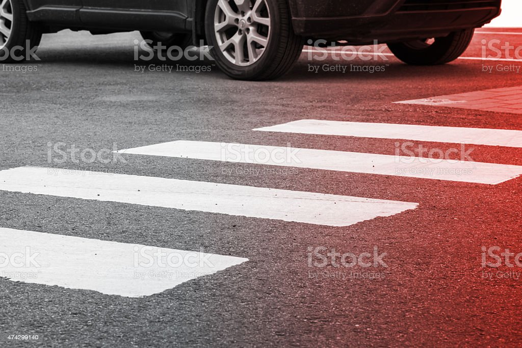 Pedestrian crossing road marking and moving car stock photo