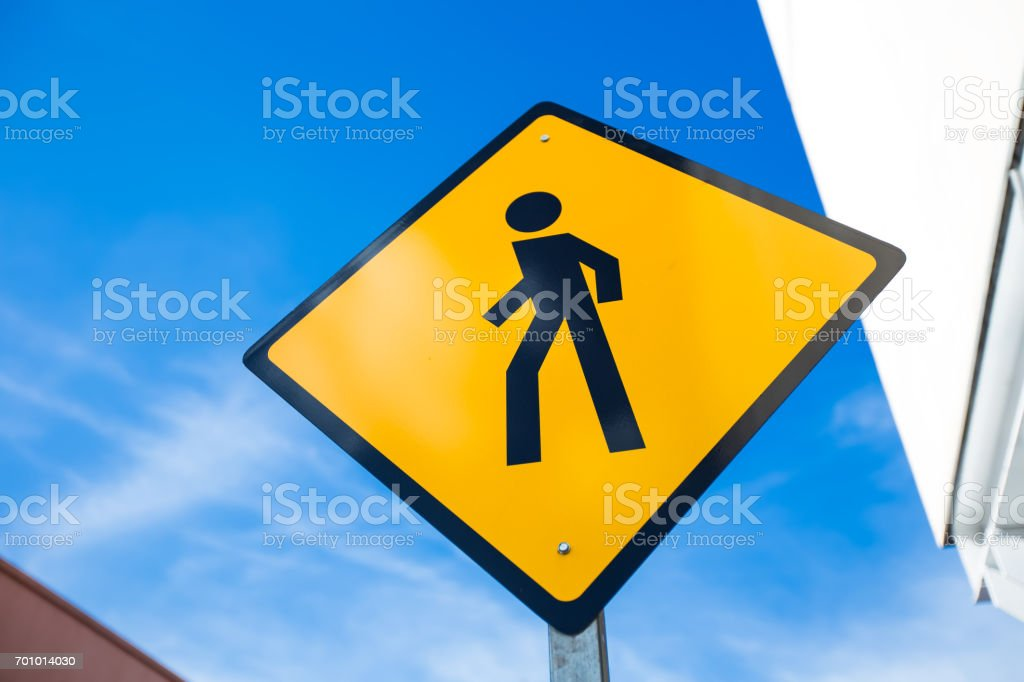 Pedestrian crossing street sign at the street stock photo