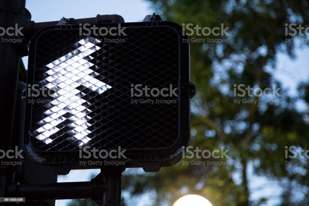 Pedestrian crosswalk traffic intersection signal light. stock photo