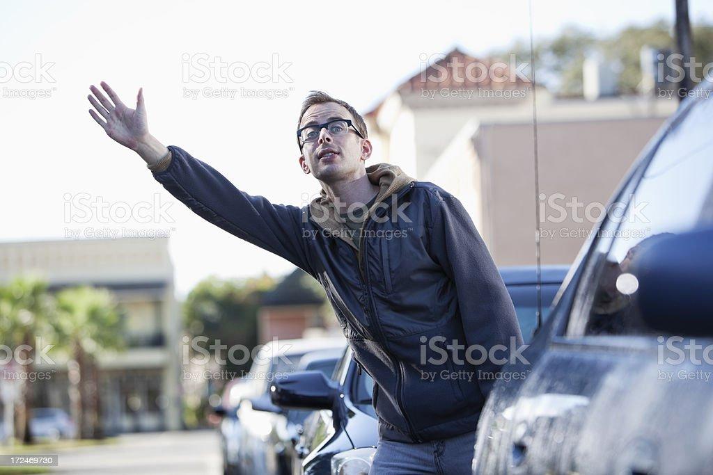 Pedestrian hailing a cab royalty-free stock photo