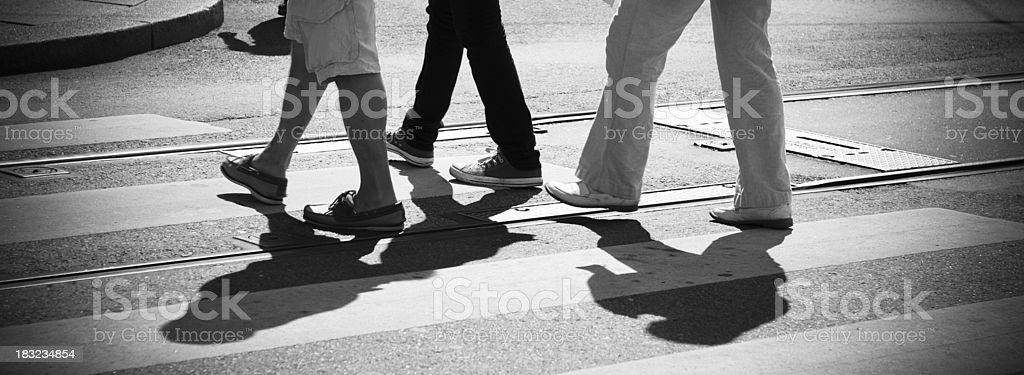 Pedestrian on the rush hour crossing street - crowed people stock photo