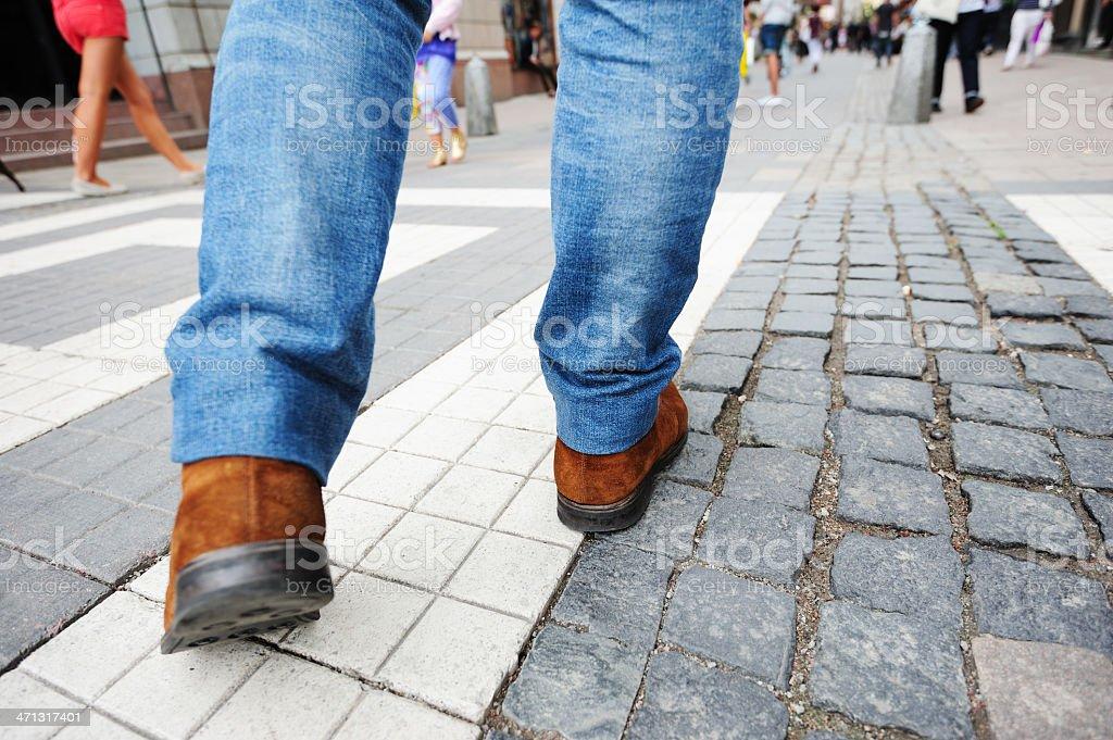 Pedestrian on tiled street stock photo