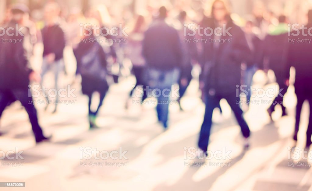 pedestrian on zebra in motion blur stock photo