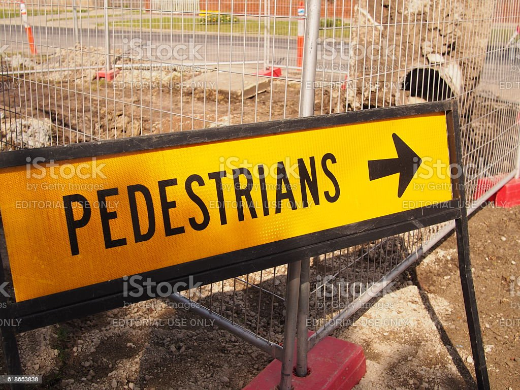 Pedestrian sign besides road works stock photo