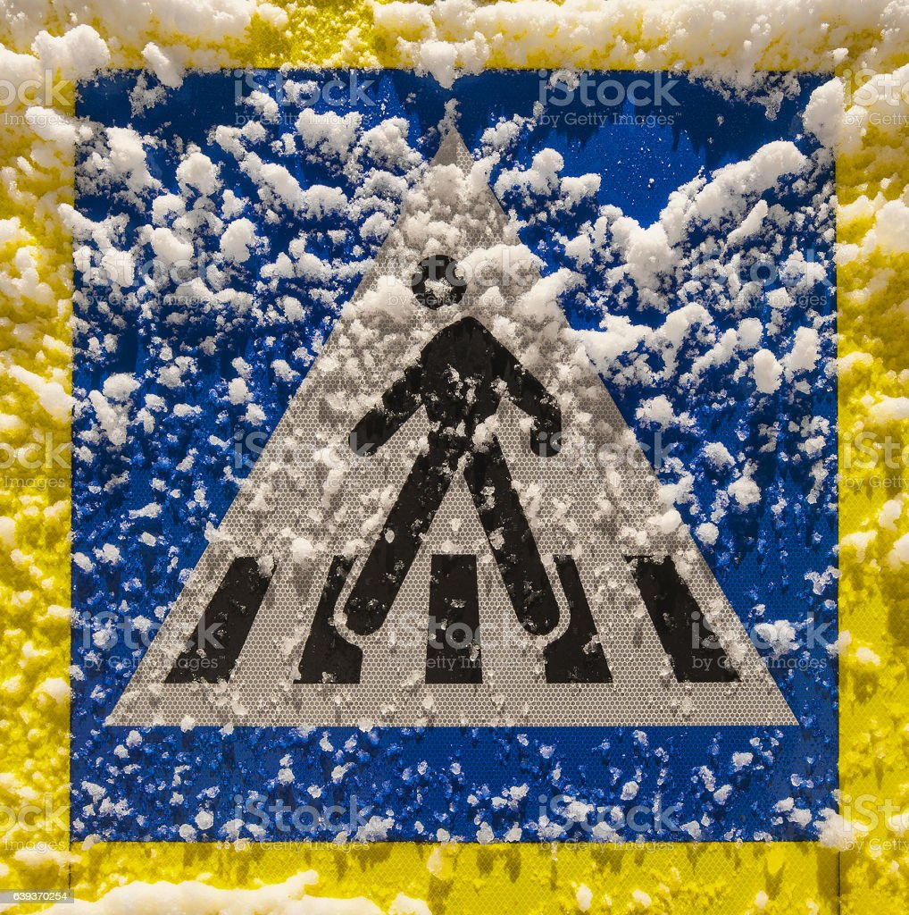 Pedestrian sign covered with snow stock photo
