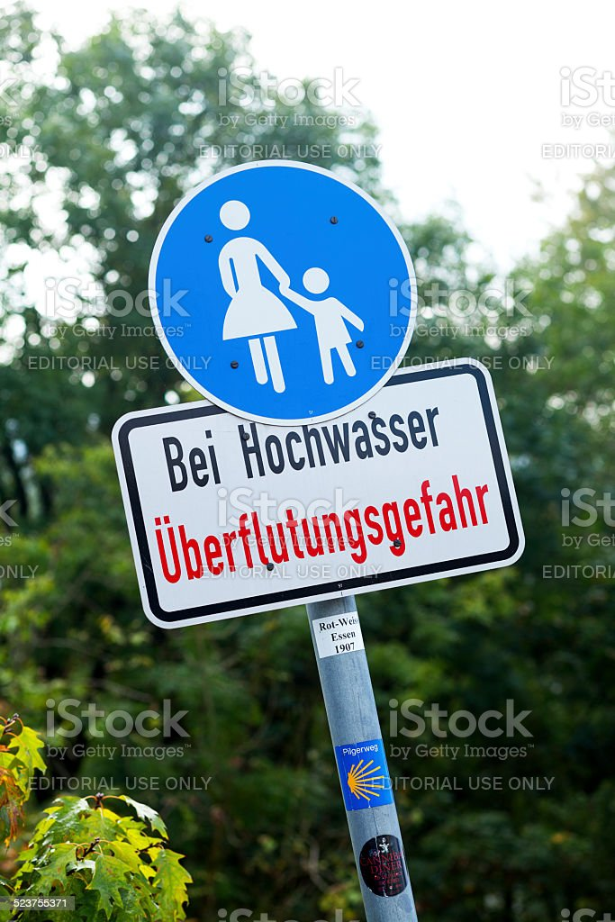 Pedestrian sign with highwater hint stock photo