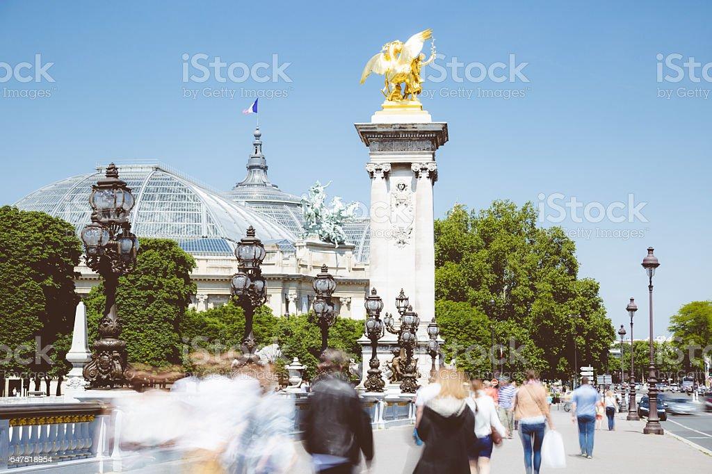 Pedestrian traffic on Pont Alexandre III stock photo