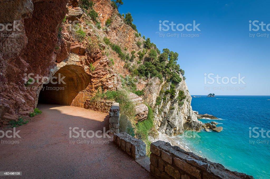 Pedestrian tunnel through the rocks stock photo