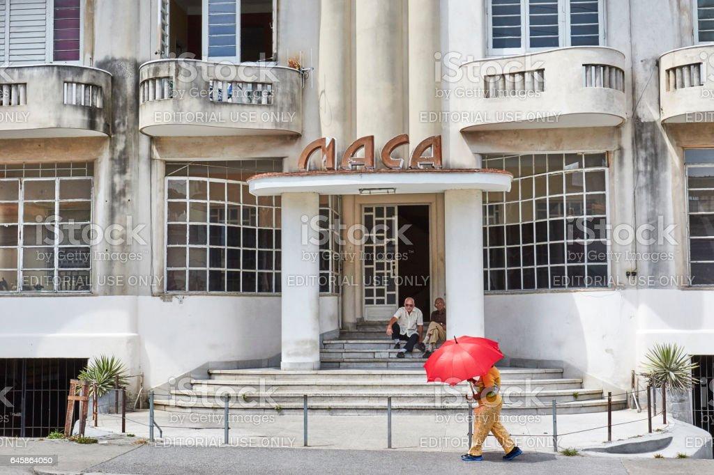 Pedestrian Uses Umbrella to Fend Off Heat, Havana Cuba stock photo