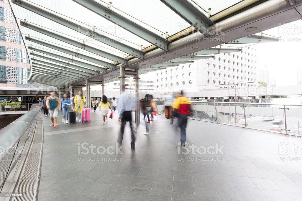 pedestrian walking on street stock photo