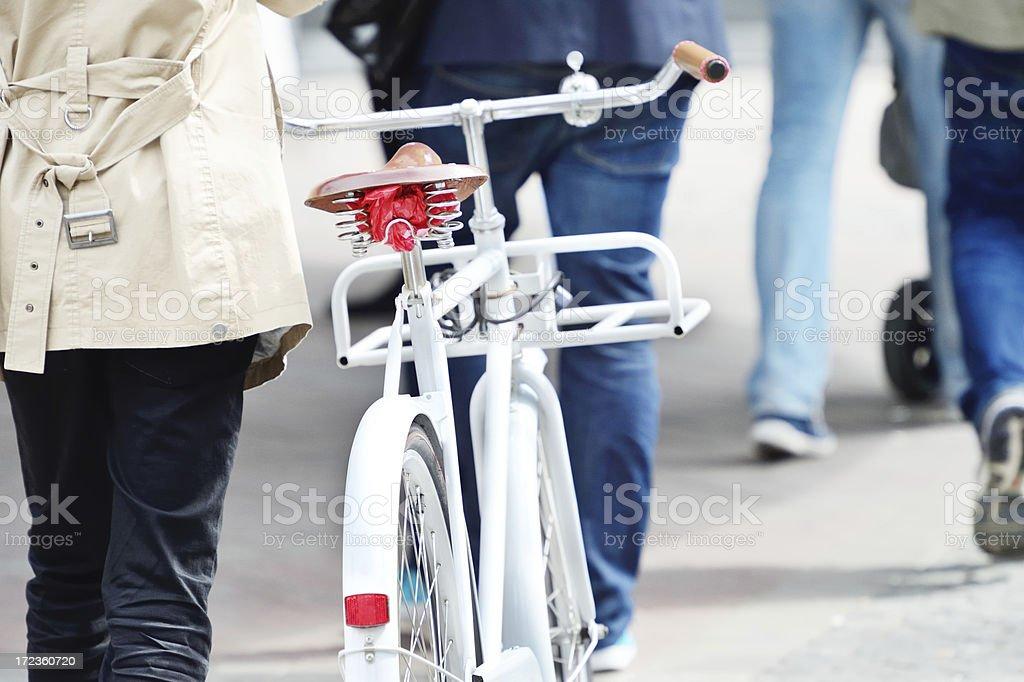 Pedestrian with bike crossing street royalty-free stock photo