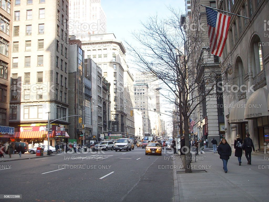 Pedestrians and Cars on 5th Avenue in Manhattan. stock photo