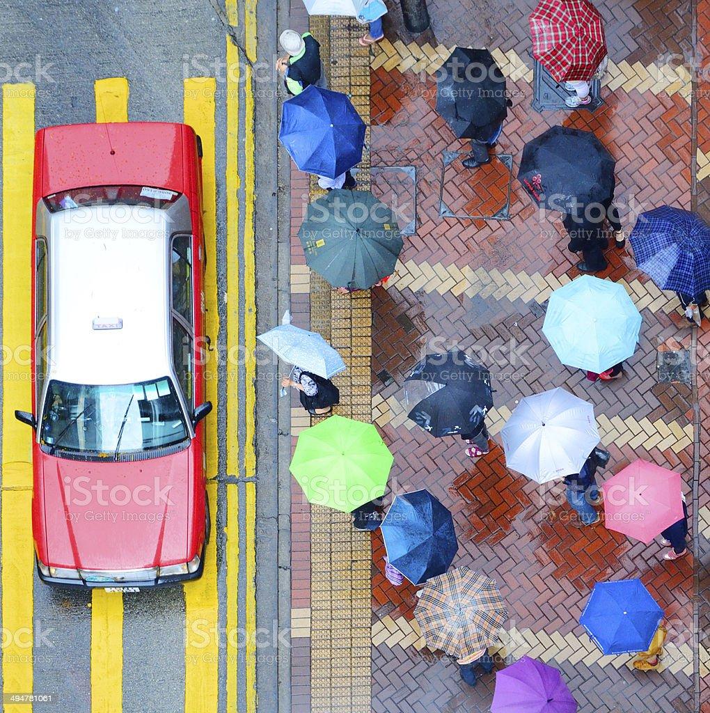 Pedestrians and Hong Kong street in the rain stock photo