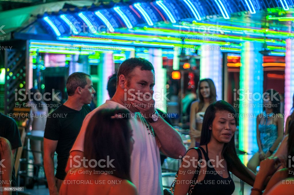 Pedestrians And Staff Outside Bars In Soi Cowboy, Bangkok, Thailand stock photo