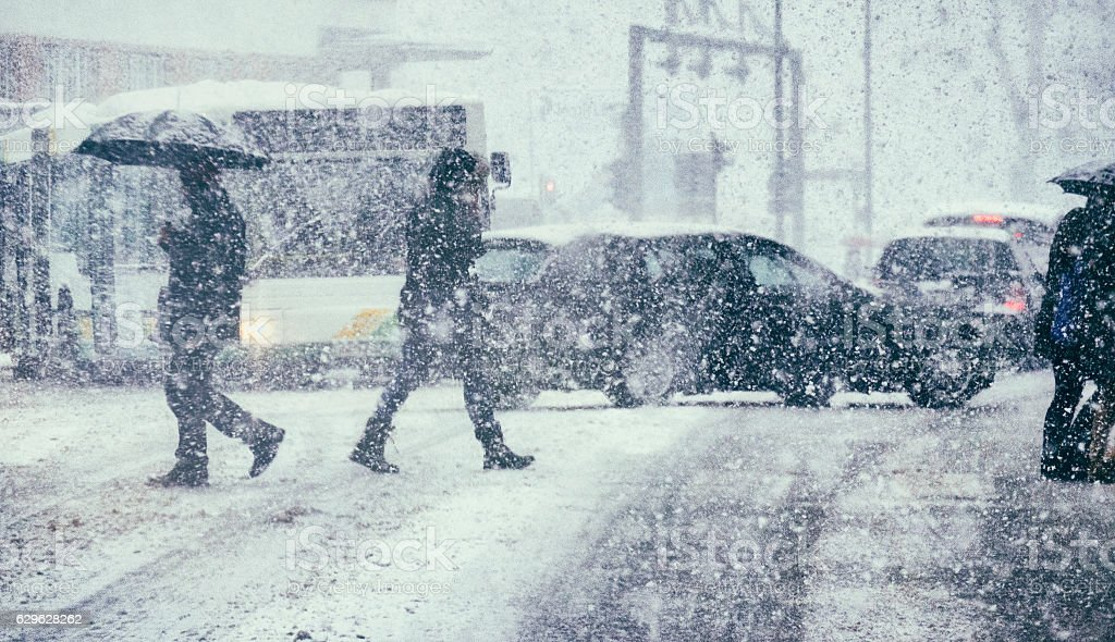Pedestrians and traffic on a winter day stock photo
