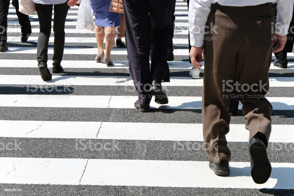 Pedestrians cross at Shibuya Crossing stock photo