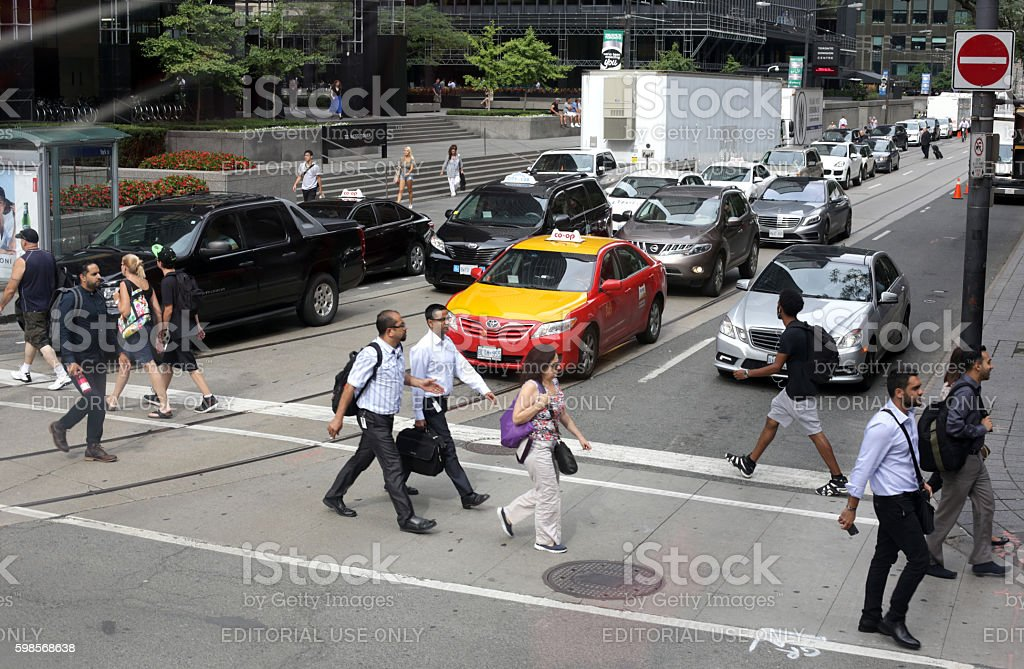 Pedestrians Cross York Street and Wellington, Toronto's Financial District stock photo